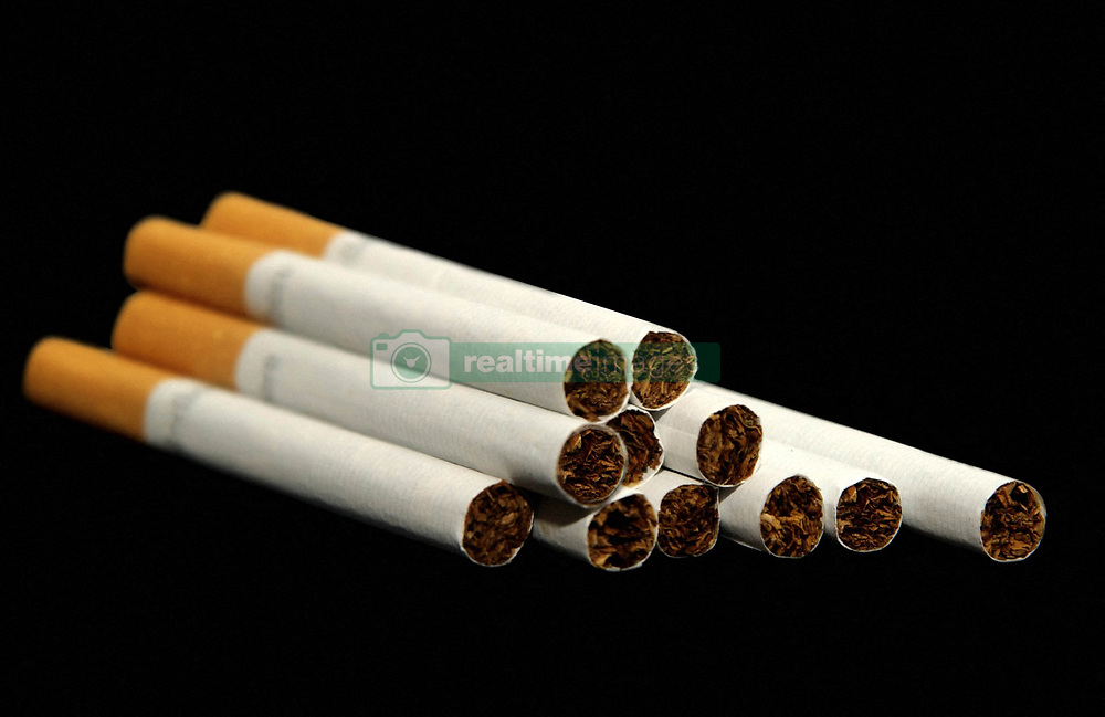File photo dated August 27, 2010 of cigarettes. A French study found that only 4.4% of 350 coronavirus patients hospitalized were regular smokers and 5.3% of 130 homebound patients smoked. This pales in comparison with at least 25% of the French population that smokes. Researchers theorized nicotine could prevent the virus from infecting cells or that nicotine was preventing the immune system from overreacting to the virus. To test this theory, hospitalized coronavirus patients, intensive care patients and frontline workers nicotine patches. Photo by ANDBZ/ABACAPRESS.COM
