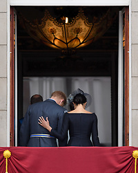 The Duke and Duchess of Sussex leave the balcony at Buckingham Palace where they watched a Royal Air Force flypast over central London to mark the centenary of the Royal Air Force.