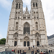 Front outside plaza at the Cathedral of St. Michael and St. Gudula (in French, Co-Cathédrale collégiale des Ss-Michel et Gudule). A church was founded on this site in the 11th century but the current building dates to the 13th to 15th centuries. The Roman Catholic cathedral is the venue for many state functions such as coronations, royal weddings, and state funerals. It has two patron saints, St Michael and St Gudula, both of whom are also the patron saints of Brussels.