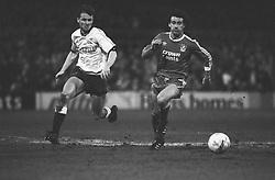 Craig Johnston (r), Liverpool, runs with the ball