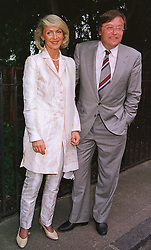 MR DAVID MELLOR and his close friend PENNY, VISCOUNTESS COBHAM, at a party in London on 30th June 1999.MTY 47