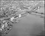 """ackroyd_10075-5. """"Balfour - Guthrie. Aerial Irving Dock. December 2, 1960"""" (Willamette river from the Broadway Bridge north to Albina Engine & Machine.)"""