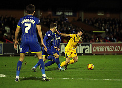 Ollie Clarke of Bristol Rovers tries to get away from the tackles of the AFC Wimbledon players - Mandatory byline: Robbie Stephenson/JMP - 07966 386802 - 26/12/2015 - FOOTBALL - Kingsmeadow Stadium - Wimbledon, England - AFC Wimbledon v Bristol Rovers - Sky Bet League Two