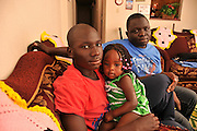 """Tucsonans, Ochana Otto, 17, (left), and Okello Otto, 29, (right), fled Sudan and came to the United States as refugees. Okello's 17-month-old daughter, Emily, was born in the U.S. Ochana, a Tucson High School student, said, """"We are happy to be a part of the Tucson community."""" Okello works nights and will attend the University of Arizona to study engineering."""