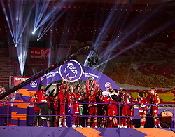 LIVERPOOL, ENGLAND - Wednesday, July 22, 2020: Liverpool's Alex Oxlade-Chamberlain lifts the Premier League trophy during the presentation as the Reds are crowned Champions after the FA Premier League match between Liverpool FC and Chelsea FC at Anfield. The game was played behind closed doors due to the UK government's social distancing laws during the Coronavirus COVID-19 Pandemic. (Pic by David Rawcliffe/Propaganda)