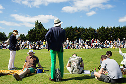 People wait in the queue during day one of the Wimbledon Championships at the All England Lawn Tennis and Croquet Club, Wimbledon. Photo credit should read: Katie Collins/EMPICS
