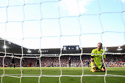 West Ham United goalkeeper Joe Hart kneels dejected after conceding the third goal during the Premier League match at St Mary's, Southampton.