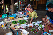 Traditional rural Thai meal the family sits on mats on the floor