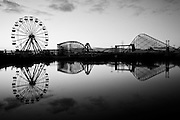 Reflections of the Big Easy ferris wheel and the Mega Zeph roller coaster as the sun sets over the abandoned Six Flags in East New Orleans - five years later after Hurricane Katrina.