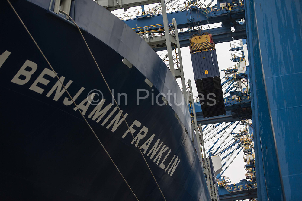 Containers being loaded onto CMA CGM SAs Benjamin Franklin container ship while the ship is docked at the Guangzhou Nansha Container Port in Guangzhou, China, on Monday, Feb. 1, 2016. The Benjamin Franklin is the largest container ship ever to have docked at a U.S. port.
