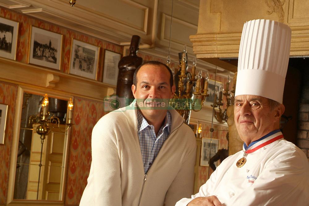 """Collonges au Mont d'Or (69) : Le chef etoile Paul Bocuse, surnomme """"Le Pape de la cuisine"""" chez lui a l'Auberge du pont de Collonges, ici accompagne de son fils, Jerome, chef cuisinier qui preside le Sirha, salon international de l'hotellerie, la restauration et l'alimentation organise a Lyon. (Mars 2006) High cuisine chef Paul Bose died at 91 it was announced on Saturday. Photo by Soudan/ANDBZ/ABACAPRESS.COM"""