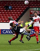 Photo: Mark Stephenson.<br /> Walsall v Port Vale. Coca Cola League 1. 08/09/2007.Port Vale's George Pilkington (F) cleares the ball from Walsall's Paul Hall