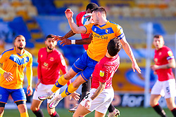 Ollie Clarke of Mansfield Town jumps to head the ball - Mandatory by-line: Ryan Crockett/JMP - 27/02/2021 - FOOTBALL - One Call Stadium - Mansfield, England - Mansfield Town v Morecambe - Sky Bet League Two