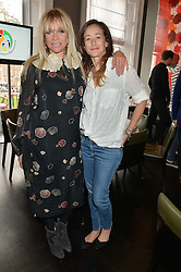 Left to right, JO WOOD and LEAH WOOD at the mothers2mothers Mother's Day Tea hosted by Nadya Abela at Morton's, Berkeley Square, London on 12th March 2015.  mothers2mothers is a charity working to eliminate mother to child transmission of HIV/AIDS across sub-Saharan Africa.