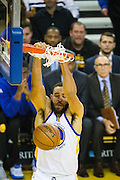 Golden State Warriors guard Patrick McCaw (0) finishes a dunk against the Los Angeles Lakers at Oracle Arena in Oakland, Calif., on November 23, 2016. (Stan Olszewski/Special to S.F. Examiner)
