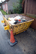 Skip full of waste from house clearance