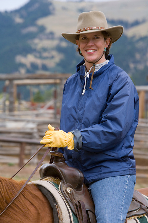 United States, Montana, Livingston, woman on horse at dude ranch  MR