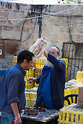 Waving the chicken over the believers head, to collect the sins. Mea Shearim, Jerusalem, Israel<br /> Kaparot, an aged old Jewish tradition were a chicken is waved over the believer?s head, reliving the person from all sins which are passed on to the chicken. The chicken is slaughtered and at times given to charity.