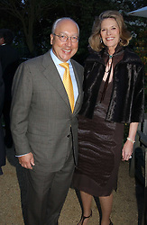 MR & MRS URS SCHWARZENBACH at the Cartier Chelsea Flower Show dinat the annual Cartier Flower Show Diner held at The Physics Garden, Chelsea, London on 23rd May 2005.<br /><br />NON EXCLUSIVE - WORLD RIGHTS
