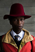 A portrait of a man wearing a red hat during London Fashion Week outside the National Theatre on 19th February 2017 on the Southbank, London, United Kingdom. London Fashion Week is a clothing trade show held in London twice each year, in February and September.