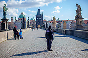 A police woman on Charles Bridge. On March 1st, 2021 the state of emergency in the Czech Republic was reinstalled because of fast increasing numbers in infections. The lockdown was reinstated and the restriction of the free movement of people has taken effect. Currently, the country remains at the highest stage of the anti-epidemiological system and the newly imposed restriction will last at least three weeks to curb the epidemic.
