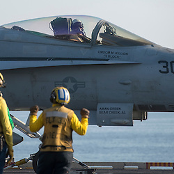USS John C Stennis CVN-74 Aircraft Carrier.Pic Shows F-18's waiting to take off