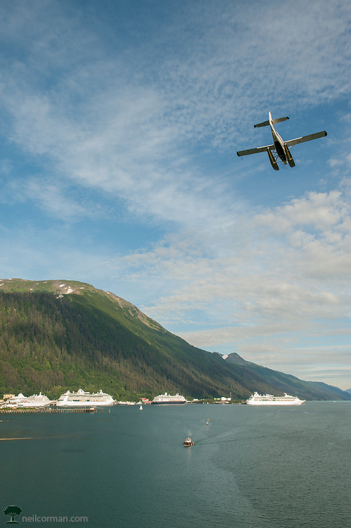 It really is a tale of two seasons in the state capitol of Alaska. In the summer the cruise ship season takes over the city. This image shows a typical day during the summer season in downtown. Numerous cruise ships in port and the float planes arriving from their tours of the area.