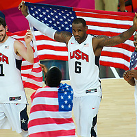 Members of the 'Dream Team,' including (L-R) Kevin Love, LeBron James, and Kevin Durant, celebrate after winning the gold medal basketball game against Spain during the 2012 London Summer Olympics.
