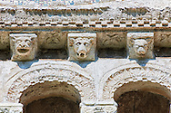13th century Romanesque  reilief sculptures depicting monsters and mythical animals on the loggia corbels of the  8th century Romanesque Basilica church of St Peters, Tuscania, Lazio, Italy .<br /> <br /> Visit our ITALY PHOTO COLLECTION for more   photos of Italy to download or buy as prints https://funkystock.photoshelter.com/gallery-collection/2b-Pictures-Images-of-Italy-Photos-of-Italian-Historic-Landmark-Sites/C0000qxA2zGFjd_k .<br /> <br /> Visit our MEDIEVAL PHOTO COLLECTIONS for more   photos  to download or buy as prints https://funkystock.photoshelter.com/gallery-collection/Medieval-Middle-Ages-Historic-Places-Arcaeological-Sites-Pictures-Images-of/C0000B5ZA54_WD0s