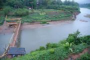 Luang Prabang, Laos. Nam Khan river with bamboo toll bridge.