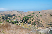Visitors walk around  the former Scorpion Ranch, which is now the primary visitation location on Santa Cruz Island, Channel Islands National Park, California, USA.