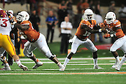 AUSTIN, TX - OCTOBER 18:  Tyrone Swoopes #18 of the Texas Longhorns hands the ball off to Malcolm Brown #28 against the Iowa State Cyclones on October 18, 2014 at Darrell K Royal-Texas Memorial Stadium in Austin, Texas.  (Photo by Cooper Neill/Getty Images) *** Local Caption *** Tyrone Swoopes; Malcolm Brown