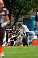 KELOWNA, BC - SEPTEMBER 8:  Robie Holland #72 of the Okanagan Sun kneels on the sidelines and speaks to athletic therapist Roy Gillespie against the Langley Rams  at the Apple Bowl on September 8, 2019 in Kelowna, Canada. (Photo by Marissa Baecker/Shoot the Breeze)