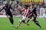 Jermaine Pennant of Stoke city © battles for the ball with Danny Gabbidon of Palace (l).  Barclays Premier league match, Stoke city v Crystal Palace at the Britannia Stadium in Stoke on Trent on Saturday 24th August 2013. pic by Andrew Orchard , Andrew Orchard sports photography,