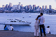 Julian Snider, 30, right, who was raised in Seattle and now lives in Toronto, Canada, embraces Rachel Riesel, 30, at Gas Works Park as they watch the light fade on Lake Union on Sept. 8.