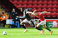 Fisayo Dele-Bashiru of Sheffield Wednesday and Alfie Bates of Walsall chase the ball during the EFL Cup match between Walsall and Sheffield Wednesday at the Banks's Stadium, Walsall, England on 5 September 2020.