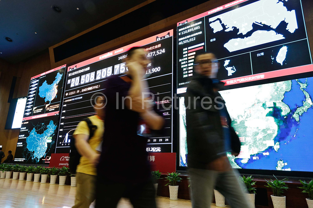 Screens showing live data feeds concerning the November 11 shopping festival at Alibaba's head quarters in Hangzhou , China on 11 November 2013. As of 2:30 PM, over 21 billion RMB 3.3 billion USD of sales were made through the internet portal. Alibaba, the parent company of T Mall, recorded $5.78 billion of sales during this Chinese version of Black Friday in 2013, as people in China increasingly log on to their computers to shop.