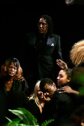 Dec 21, 2007 - Gardena, CA, USA -  RONALD TURNER , the only son of Ike and Tina Turner, and IKE TURNER JR in the foreground grieve at the funeral for Ike Turner, who was considered one of the founding fathers of rock music, but his career was often overshadowed by run - ins with the law and a stormy marriage to Tina Turner.  Turner died December 12 at his home in San Marcos. He was 76.  Photo by Jonathan Alcorn/ZUMA Press. © Copyright 2007 by Jonathan Alcorn (Credit Image: © Jonathan Alcorn/ZUMAPRESS.com)