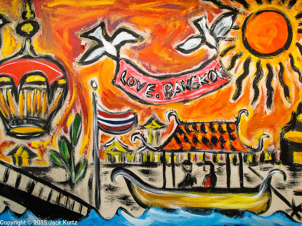 06 FEBRUARY 2015 - BANGKOK, THAILAND: A mural on a wall in the neighborhood near Santa Cruz Church in the Thonburi section of Bangkok. The neighborhood around the church is known for the Thai adaptation of Portuguese cakes baked in the neighborhood. Several hundred Siamese (Thai) Buddhists converted to Catholicism in the 1770s. Some of the families started baking the cakes. When the Siamese Empire in Ayutthaya was sacked by the Burmese, the Portuguese and Thai Catholics fled to Thonburi, in what is now Bangkok. The Portuguese established a Catholic church near the new Siamese capital. There are still a large number of Thai Catholics living in the neighborhood around the church.       PHOTO BY JACK KURTZ