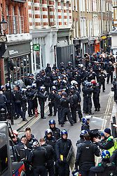 © Licensed to London News Pictures.  11/06/2013. LONDON, UK.Police officers in Beak Street, where a squat was raided earlier today as part of a large policing operation related to an anti G8 protest.  Photo credit: Cliff Hide/LNP