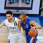 Efes Pilsen's Ender ASLAN (L) and Mersin BSB's Anthony GRUNDY (R) during their Turkish Basketball league match Efes Pilsen between Mersin BSB at the Sinan Erdem Arena in Istanbul Turkey on Saturday 19 March 2011. Photo by TURKPIX