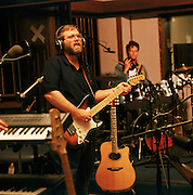 Paul Allen, co-founder of Microsoft and billionaire.  Jamming is his recording studio in Mercer Island, Washington.