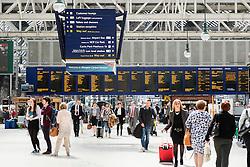 busy public concourse at Glasgow Central Station in Glasgow United Kingdom