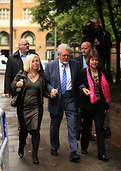 Licensed to London News Pictures. London, UK. 04/06/2014. Former BBC TV entertainer ROLF HARRIS arrives at Southwark Crown Court in London today (04/06/2014) with his daughter Bindi Harris, left, and niece Jenny, right, as the trial continues for 12 charges of indecent assault.