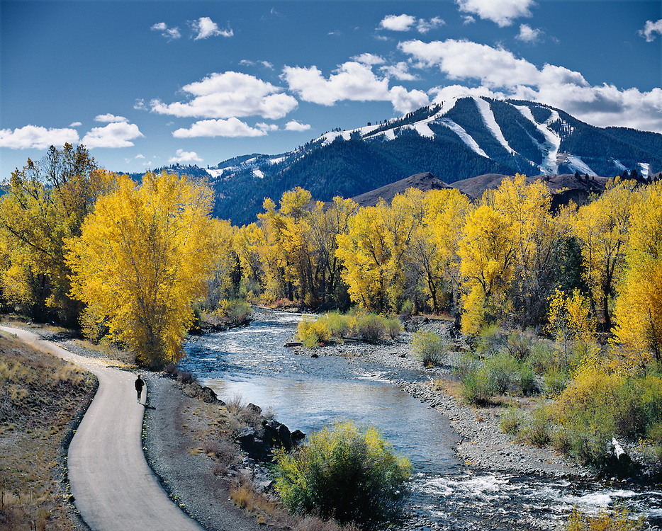 Open Edition Fine Art Photograph<br /> A Jogger Runs Along the Bike Path and the Wood River on a Spectacular Autumn Day