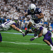 Dec 30  2017  Glendale, AZ  U.S.A. Penn State running back Saquon Barkley (26) rushing stats 18/145 yards and 2 touchdowns jump over Washington defensive back Taylor Rapp (21) for extra yards during the NCAA Playstation Fiesta Bowl football game between Washington Huskies and the Penn State Nittany Lions 35-28 win at University of Phoenix Stadium Glendale, AZ. Thurman James / CSM