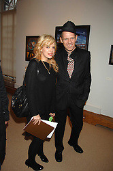 LILY ALLEN and PAUL SIMONON at a private view of Paul Simonon's recent paintings held at Thomas Williams Fine Art, 22 Old Bond Street, London on 15th April 2008.<br />