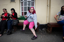 © Licensed to London News Pictures . 30/05/2014 . Manchester , UK . LESLEY COUPS (38 from Bradford) points to a tattoo of Donnie Wahlberg on her leg . New Kids on the Block fans outside pub round the corner from the Apollo Theatre , ahead of a NKOTB gig tonight (30th May 2014) . Photo credit : Joel Goodman/LNP
