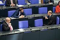"""25 MAR 2020, BERLIN/GERMANY:<br /> Peter Altmaier (L), CDU, Bundeswirtschaftsminister, Jens Spahn (M), CDU, Bundesgesundheitsminister, und Olaf Scholz (R), SPD, Bundesfinanzminister, im Gespraech. Um das Abstandsgebot zu beachten, ist nur jder dritte Platz in den Abgeordnentenreihen besetzt, Bundestagsdebatte zu """"COVID 19 - Kreditobergrenzen, Nachtragshaushalt, Wirtschaftsfonds"""", Plenum, Reichstagsgebaeude, Deutscher Bundestag<br /> IMAGE: 20200325-01-017<br /> KEYWORDS: Pandemie, Corona, Sitzung, Debatte, Gespräch"""