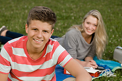 Portrait of teenage couple in park, smiling